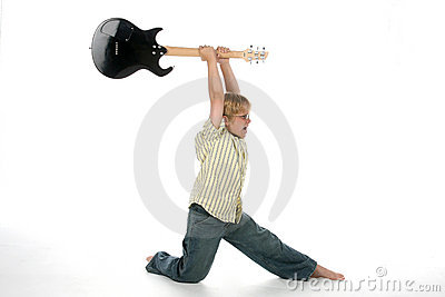 Boy smashing guitar