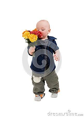 Boy smells flowers