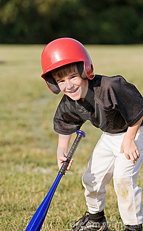 Boy Smiling Getting Ready to Hit