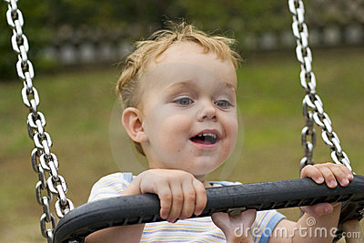Boy smiling on swing