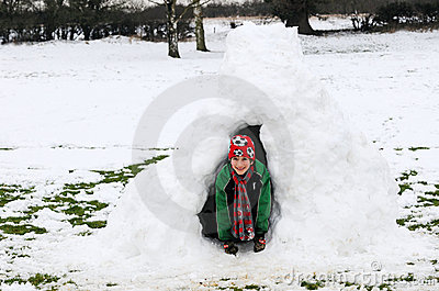 Boy in snow igloo