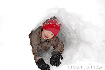 Boy in snow tunnel