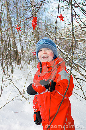 Boy in the snowy forest
