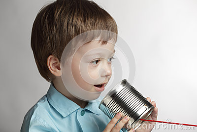 Boy speak in tin can telephone