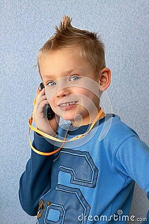 Boy speaks by telephone.