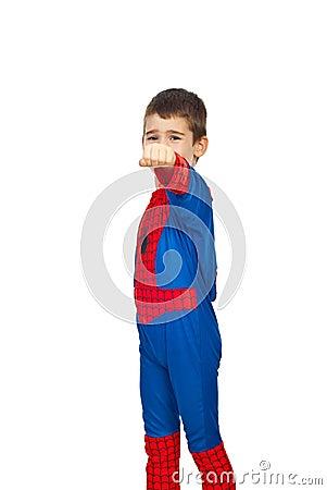 Boy in spider costume showing fist hand