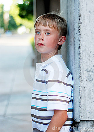 Boy Standing Against Wall - Vertical