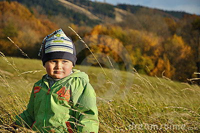 Boy standing in bent-grass