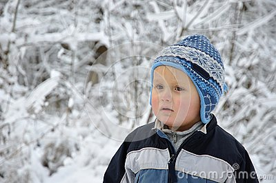 Boy standing in snowy scenery