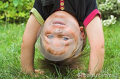 Boy standing upside down