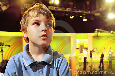 Boy stands in auditorium