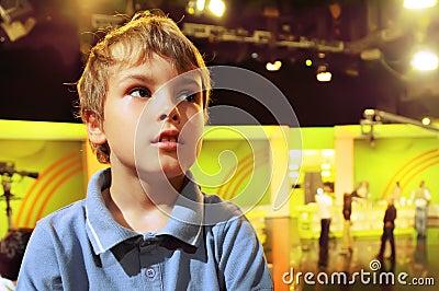 Boy stands in auditorium