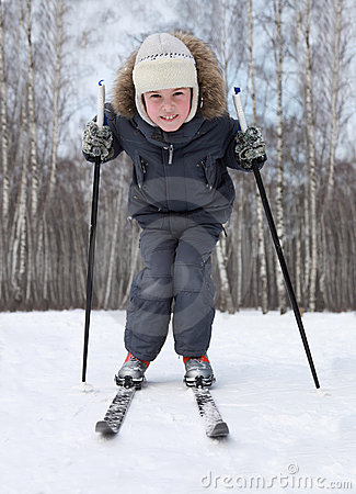 Boy stands on cross-country skis