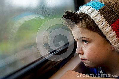 Boy staring through window