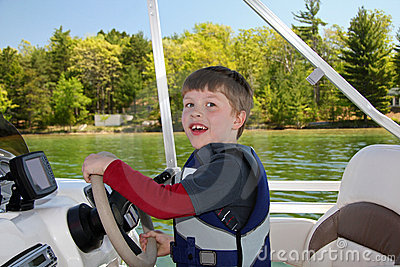 Boy Steering Boat