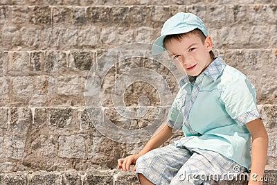 A boy on the stone steps