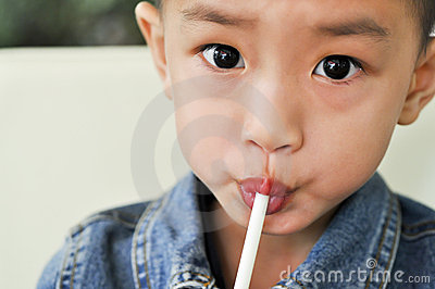 The boy with the straw