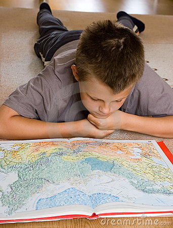 Free Boy Studying A Map Royalty Free Stock Photography - 2868147