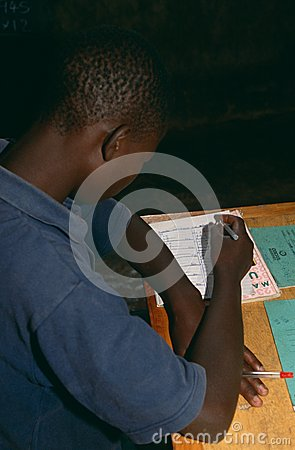 A boy studying in class, Rwanda. Editorial Stock Image
