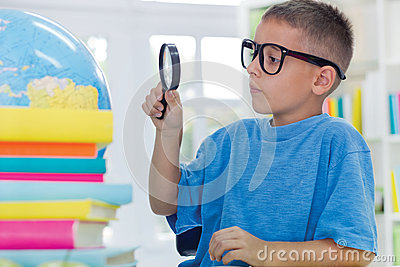 Boy studying geography
