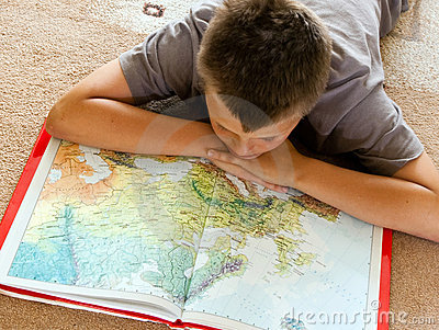 Boy studying a map