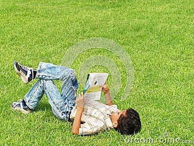 Boy Studying Outside