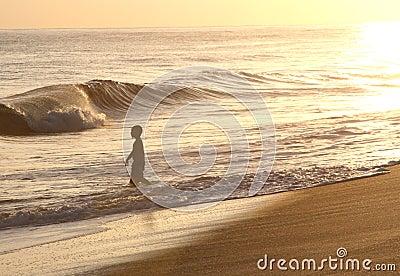 Boy at Sunset in Hawaii Ocean