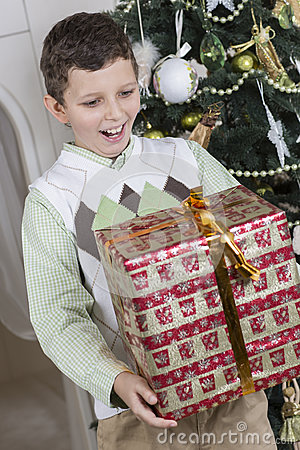 Boy is surprised with a big Christmas gift