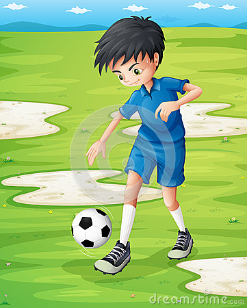 A boy sweating while playing football