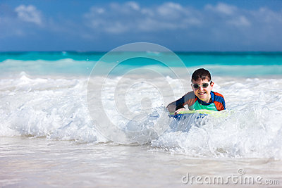 Boy swimming on boogie board