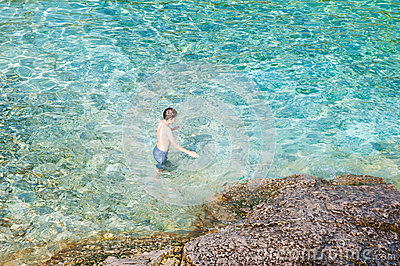 Boy Swimming In Crystal Clear Turquoise Water Stock Photo Image 58630047