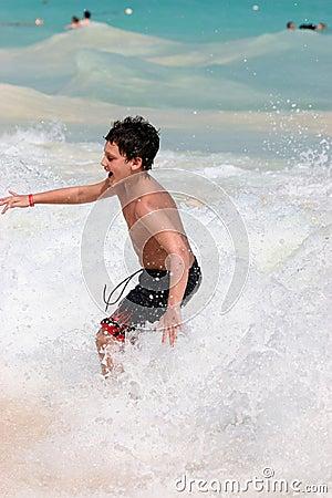Boy swimming in ocean waves