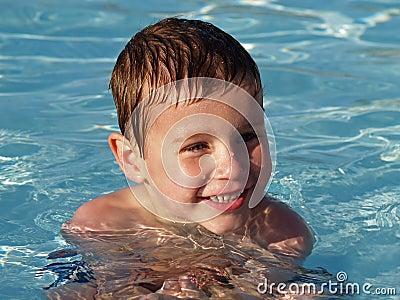 Boy in swimming pool