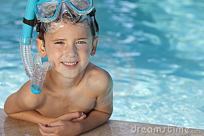 Boy In Swimming Pool With Blue Goggles & Snorkel