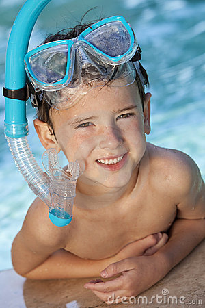 Boy In A Swimming Pool with Goggles and Snorkel