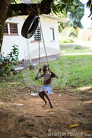 Boy on swing Editorial Image
