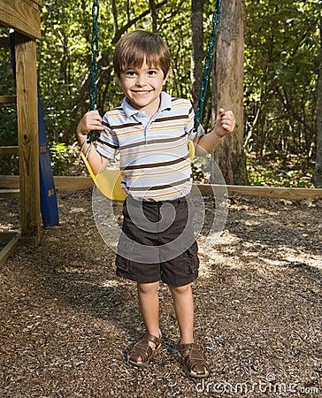 Boy on swing.