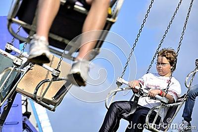Boy on Swing Ride