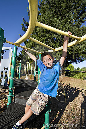 Boy Swinging on Jungle gym - Vertical