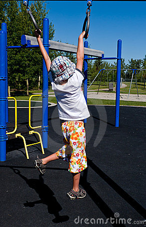 Boy swinging on rings