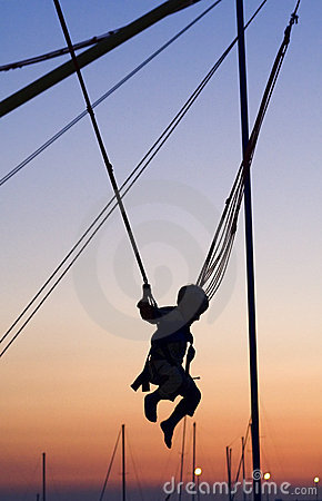 Boy swinging on ropes