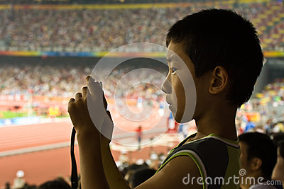 Boy takes a picture at Olympic games Editorial Photography