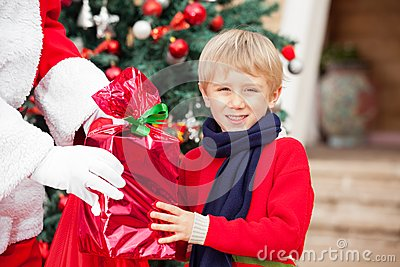 Boy Taking Gift From Santa Claus