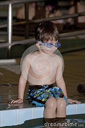 Boy taking a swim lesson