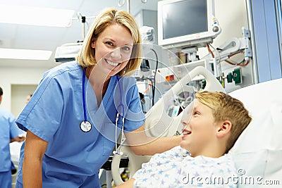 Boy Talking To Female Nurse In Emergency Room