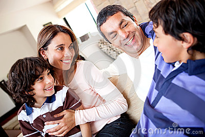 Boy talking to his family