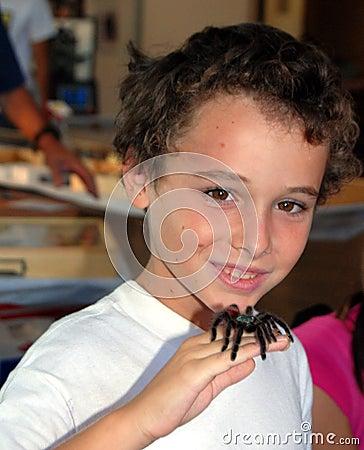 Boy with tarantula on hand