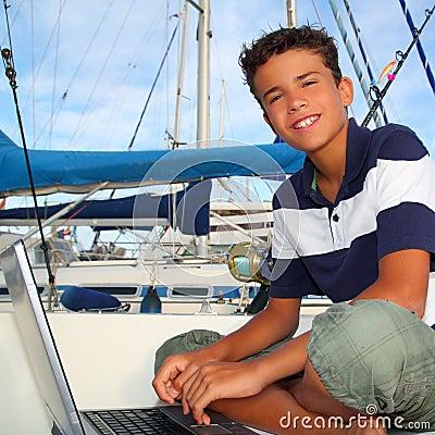 Free Boy Teen Seat On Boat Marina Laptop Computer Stock Photography - 16383042