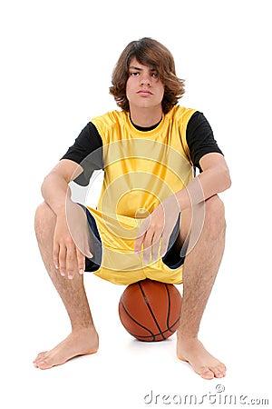 Boy Teen Sitting On Basket Ball Over White