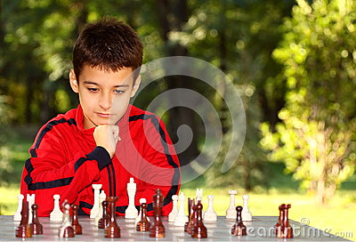 Boy thinking chess game